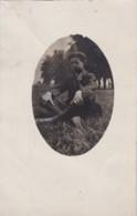 AR73 RPPC - Boy Sitting In A Field - Photographs