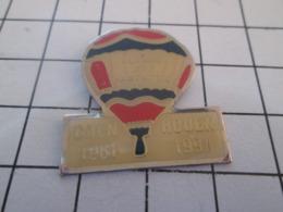 219 Pin's Pins : BEAU ET RARE : Thème MONTGOLFIERES / BALLON LIBRE ALARME ET PROTECTION 1981 1991 CAEN ROUEN - Mongolfiere