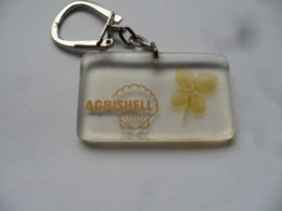 """(Porte-clés Bourbon ?? - Agriculture, Station Service ??)   -   AGRISHELL   """" Trèfle à 4 Feuilles """"  .........voir Scans - Porte-clefs"""
