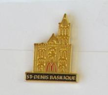 1 Pin's MAC DO - ST DENIS BASILIQUE Signé MDB - McDonald's