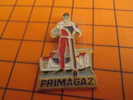 919 Pins Pin's  / Rare & Belle Qualité / THEME AUTOMOBILES / PRIMAGAZ PILOTE D'ENDURANCE - Rally