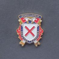 1 Pin's Sapeurs Pompiers De MUNDOLSHEIM (BAS RHIN - 67) - Brandweerman