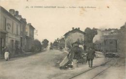CPA 33 Gironde Le Tourne Langoiran La Gare Route De Bordeaux Nouvelles Galeries Café Restaurant Train Wagon - France