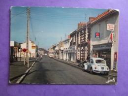CPA 44 SAINT SEBASTIEN SUR LOIRE RUE PRINCIPALE MAURICE DANIEL COMMERCES VOITURE ANCIENNE COCCINELLE - Saint-Sébastien-sur-Loire