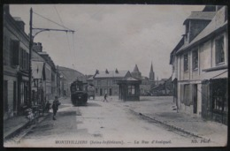 "CPA - MONTIVILLIERS "" LA RUE D'ASSIQUET ""  - DATEE 1916 - TRAMWAY - ANIMEE - Montivilliers"