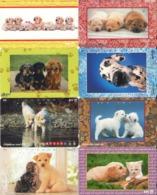 LOTE DE 8 TARJETAS TELEFONICAS DE JAPON. (PERROS - DOGS - CHIENS). (194) - Perros