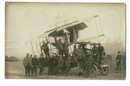Carte Photo - L'Aigle (61) - Camion R.E.O Transportant Un Avion Biplan Démonté à Proximité D'une Gare (animé) Circ 1916 - War 1914-18
