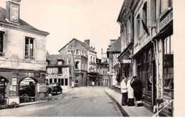 27 . N° 101531 . Cpsm .9x14 Cm  .brionne .rue Le Marrois .cafe . - Autres Communes