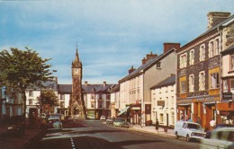 Postcard The Clock Tower Machynlleth Shops Old Cars & People  My Ref  B13756 - Montgomeryshire