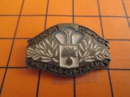 1519 Pin's Pins : BEAU ET RARE : Thème POMPIERS / SAPEURS POMPIERS D'AMNEVILLE LES THERMES - Brandweerman