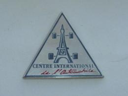 Pin's CENTRE INTERNATIONAL DE L AUTOMOBILE A, ARGENT - Pins