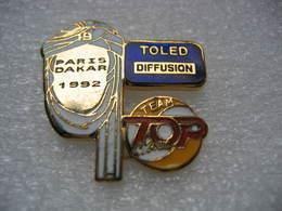 Pin's Du Fabricant De Pin's TOLED. Paris Dakar 1992 Sponsorisé Par TOLED Diffusion Et La Radio TOP MUSIC. (Le Dernier!!) - Pins