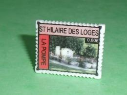 Fèves / Autres / Divers / Régions  : Timbre , St Hilaire Des Loges , La Pompe , Perso T119 - Regionen