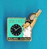 1 PIN'S  //   ** BADMINTON / ROLAND GARROS / MONTRE SEIKO ** - Badminton