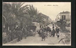 CPA Arzew, Rue D`Italy, Bevölkerung, Lastwagen Et Häuserfassaden - Algiers
