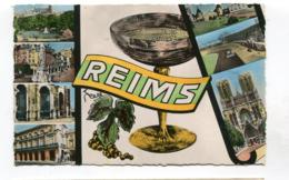 CPsm  51 : REIMS  Multi Vues Avec Stade De Football     A  VOIR  !!!!!!! - Reims