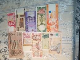COLLECTION DE 10 BANKNOTES UNC..... - Banconote