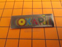 1318c Pin's Pins / Beau Et Rare / Thème MEDIAS : REVUE POUR ENFANTS OKAPI - Medias