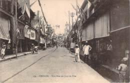 Vietnam Indochine - Cholon - Une Rue Un Jour De Fête - Vietnam