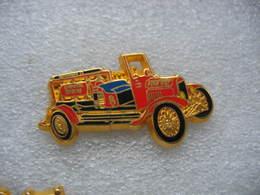 Pin's BALLARD, Ancien Camion FORD Modele T-CHEMICAL UNIT Des Sapeurs Pompiers - Bomberos