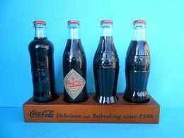 CROATIAN ISSUE ... COCA-COLA 125. YEARS - Full Set Of 4. Glass Bottles * FULL UNOPENED BOTTLES ON A SPECIAL RACK - Bottles