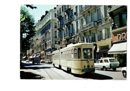 Cpm - 42 -  Saint Etienne - La Grande Artère Et Le Tramway - N°1030 Baure - Voiture Peugeot 404 - Saint Etienne