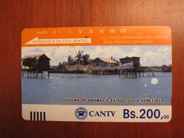 Tamura Phonecard,Laguna De Sinamaica, Silver Backside, Earlier Card, Used With A Little Scratch - Venezuela