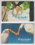 KYRGYZSTAN 2004 COUPLE HOLDING HANDS 2 PHONE CARDS - Kirgisistan