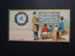 CHROMO.  Chocolat  SUCHARD.  Heures De La Journée D'un Enfant.  9 Heures  Lecture. Maitre D'école. Tabeau. Horloge - Suchard