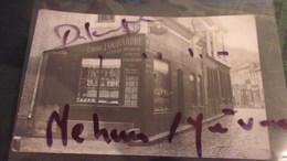 18 RARE CARTE PHOTO MEHUN SUR YEVRE TOURNADRE HORLOGER ANGLE RUE JEANNE D ARC ET RUE BARRERE BATIMENT AUJOURDHUI DISPARU - Mehun-sur-Yèvre