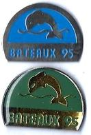 DAUPHINS - D22 - BATEAUX 95 - 2 Pin's Différents - Verso : PROMEDIF - Pin's
