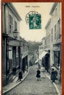 54  CPA  BRIEY   Grand'Rue   Joli Plan Animé     1912      Très Bon état - Briey