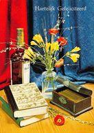 Hartelijk Gefeliciteerd Bottle Of Alcohol, Books Flowers In Vase Postcard - Gruss Aus.../ Grüsse Aus...