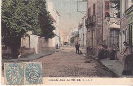 CRE- TRIEL  EN YVELINES   GRANDE RUE   CPA COLORISEE   CIRCULEE - Triel Sur Seine