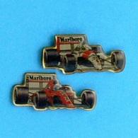 2 PIN'S  //  ** F1 / McLAREN N°1 AYRTON SENNA / 1991 / FERRARI N°27 ALAIN PROST ** - F1