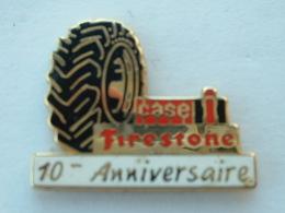 Pin's PNEU FIRESTONE - CASE - 10éme ANNIVERSAIRE - Pin's