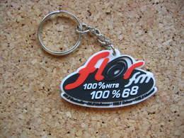 Porte Clé Neuf, Radio FLOR FM, 100% Hits, 100% 68 (Haut Rhin). Guebwiller 97,3Mhz, Mulhouse 98,6Mhz, Colmar 100,1Mhz - Sleutelhangers