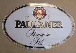 PLAQUE  EMAILLEE :PAULANER  Premium PILS ( Forme Ovale Legerement Bombée) Voir Etiquette Societe - Drank & Bier