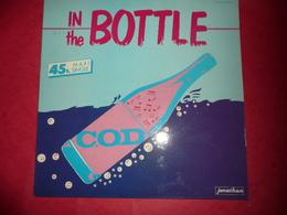 LP33 N°1073 - C.O.D. IN THE BOTTLE - COMPILATION 2 TITRES ELECTRO HIP HOP - 45 Rpm - Maxi-Singles
