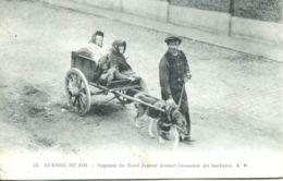 N°1453 T -cpa Attelage Chien -paysans Fuyant Devant L'invasion Des Barbares -guerre 1914- - Attelages