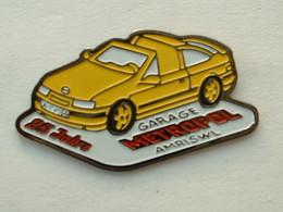 Pin's OPEL CABRIOLET - GARAGE METROPOL AMRISWL 25 JAHRE - Opel