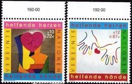 """UNO-Wien, 2001,  331/32,  MNH **,   Jahr Des Ehrenamtes: Gemäldeausstellung """"Ein Herz, Eine Welt"""", - Vienna – International Centre"""