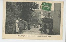 QUÉAUX - La Rue De La Fontaine Et Clocher De L'Eglise - Francia