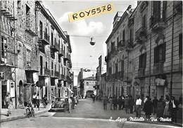 Sicilia-messina-s.agata Militello Via Medici Veduta Via Case Persone Negozi Tabacchi Auto Epoca Animatissima Anni 50 - Italia
