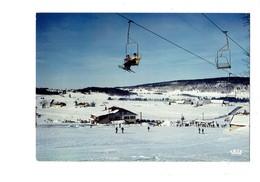 Cpm - 39 - Station De Ski Du Jura - LE NOIRMONT LES ROUSSES - Télébenne - La Cigogne - 1985 - Animation - Autres Communes