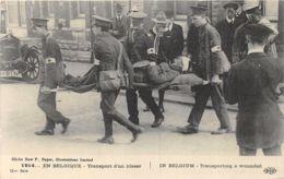 En Belgique - Transport D'un Blessé - Guerre 1914-18