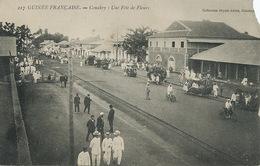 Conakry Une Fete De Fleurs  Bicyclette Fleuries Tram Decauville  Envoi Mamou Edmond Penin . Coin Cassé - Guinée