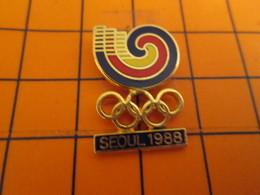 716a Pin's Pins / Beau Et Rare : Thème JEUX OLYMPIQUES / SEOUL 1988 ANNEAUX ET SORTE D'ESCARGOT ? - Jeux Olympiques