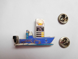 Superbe Pin's En EGF , Carburant Essence , Oil , Huile , SHELL , JO Jeux Olympiques De Sydney 2000 , Hors Bord - Carburants