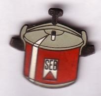 DD268 Pin's Usine Seb Groupe SEB USINE Selongey Cote D'or Achat Immédiat Cocotte Minute Immédiat - Marques